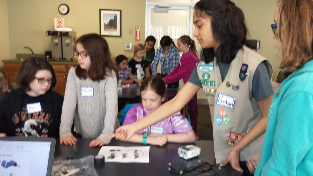 Rachael guides the participants in building their robot. Girls Robotics Camp, March 2017.