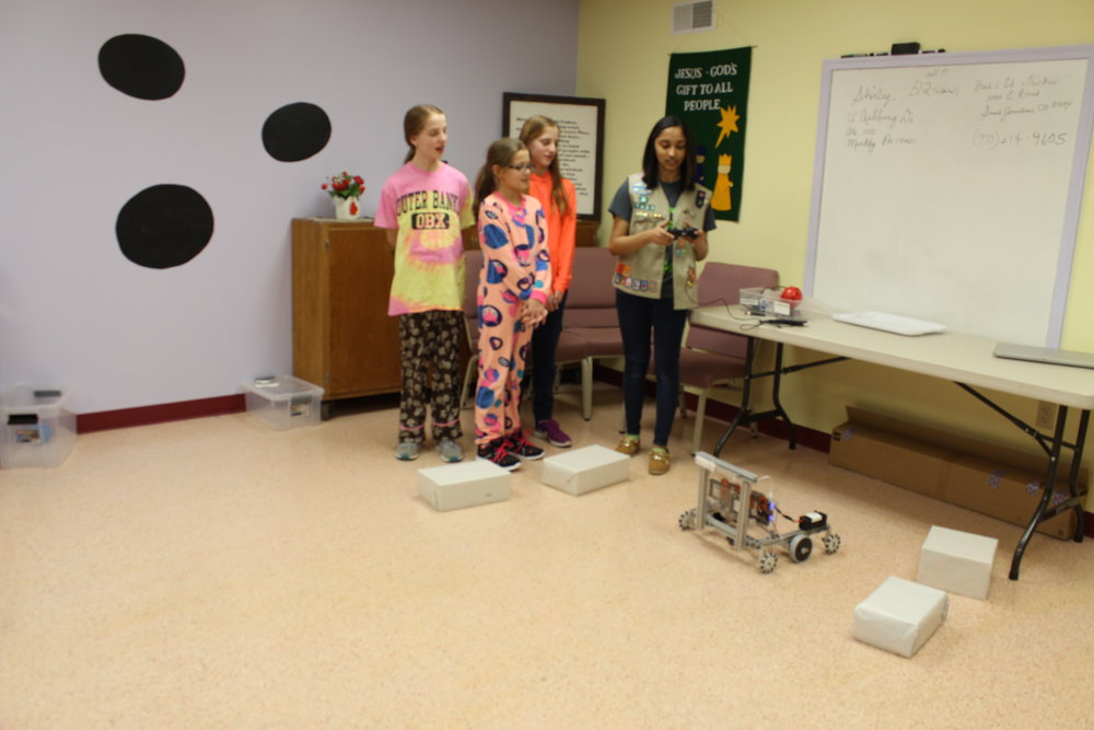 Rachael helps Girl Scouts with driving the robot. Girl Scout Lock-in Outreach, February 2017.