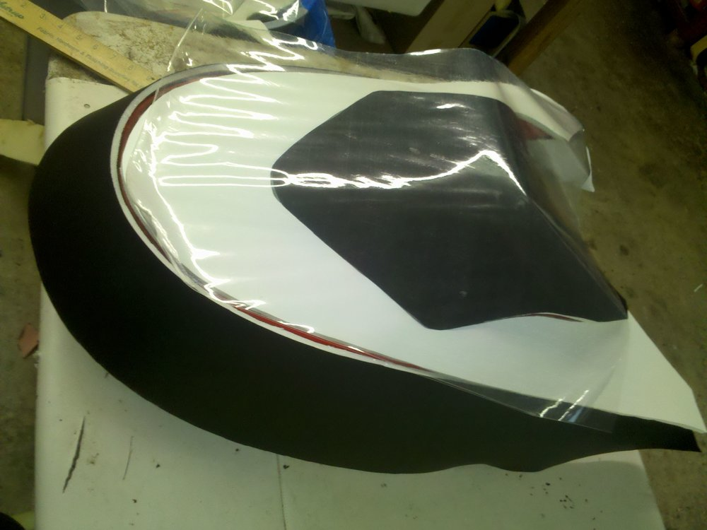 Custom marine interior provided by https://www.sunbrella.com/en-us/, diamond tucked seats, custom auto and marine upholstery and interior in michigan, ohio, canada Vinyl sewing design jet ski interior, wave runner interior
