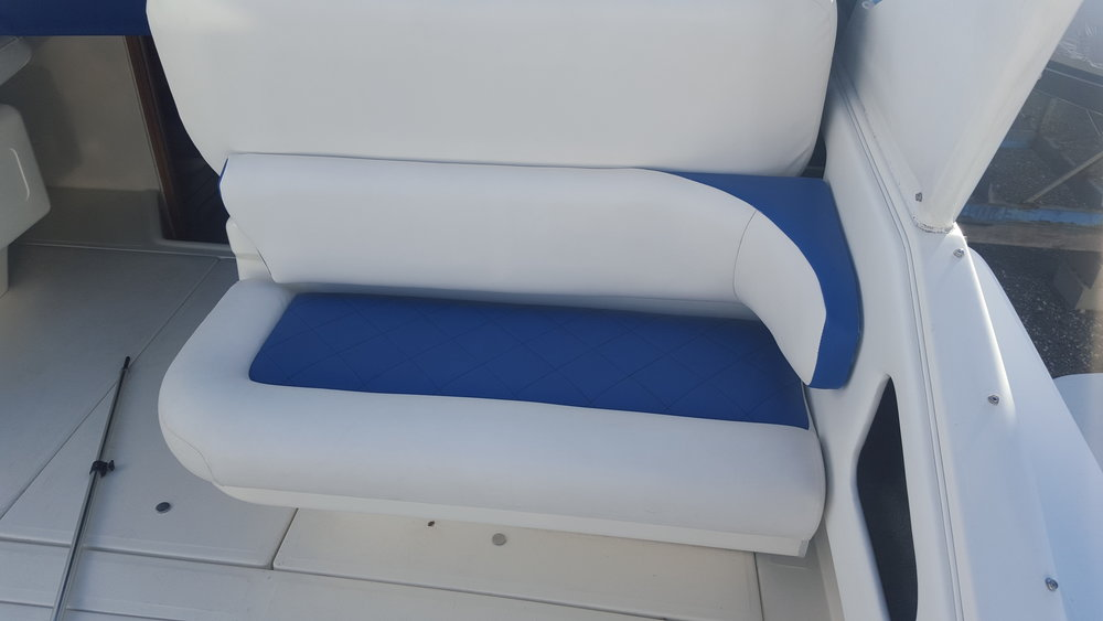 Custom marine interior provided by https://www.sunbrella.com/en-us/, diamond tucked seats, custom auto and marine upholstery and interior in michigan, ohio, canada Vinyl sewing design