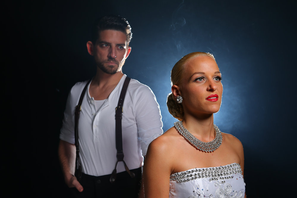 "Drew Niles as ""Che"" and Jody Bill Bachler as ""Eva Peron"" in Diamond Head Theatre's Evita."