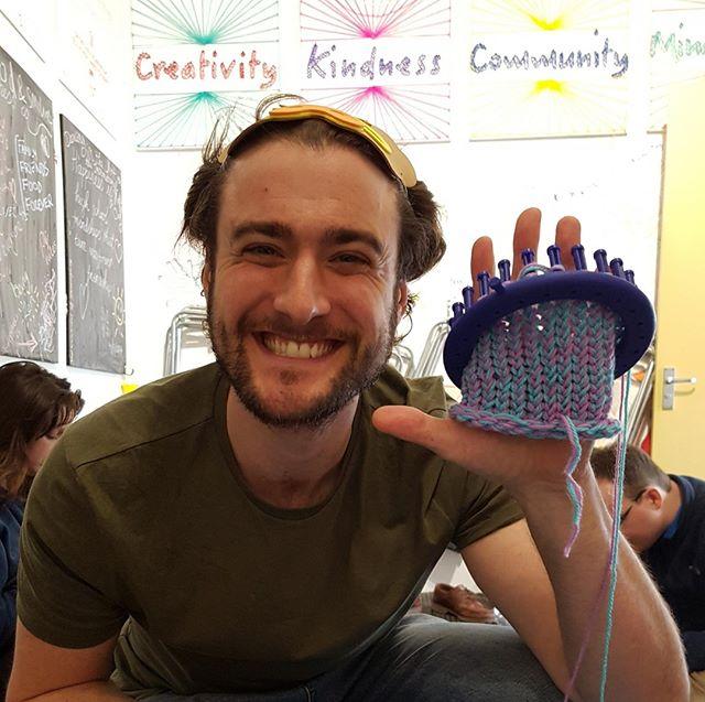 A chuffed volunteer mid-way through beanie making!