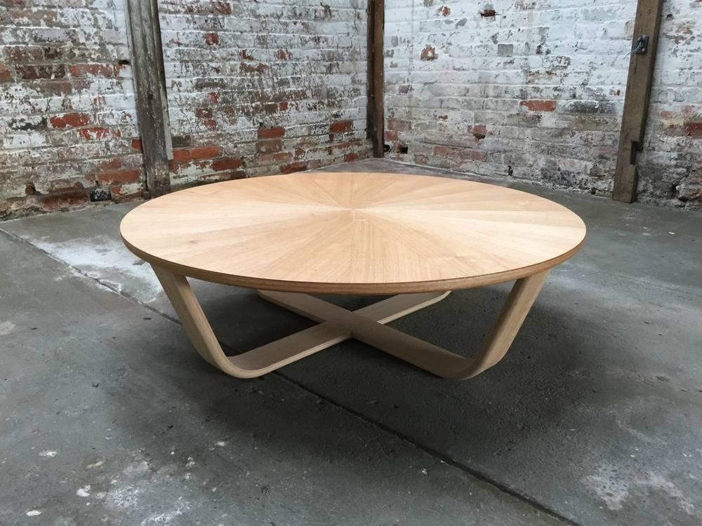This striking handcrafted coffee table was designed by Simon Ancher Studio, in Launceston TAS.  A sunburst pattern is created by arranging veneer sheets around a centre point.  The tapered shape of each segment draws the eye to the centre of the table.