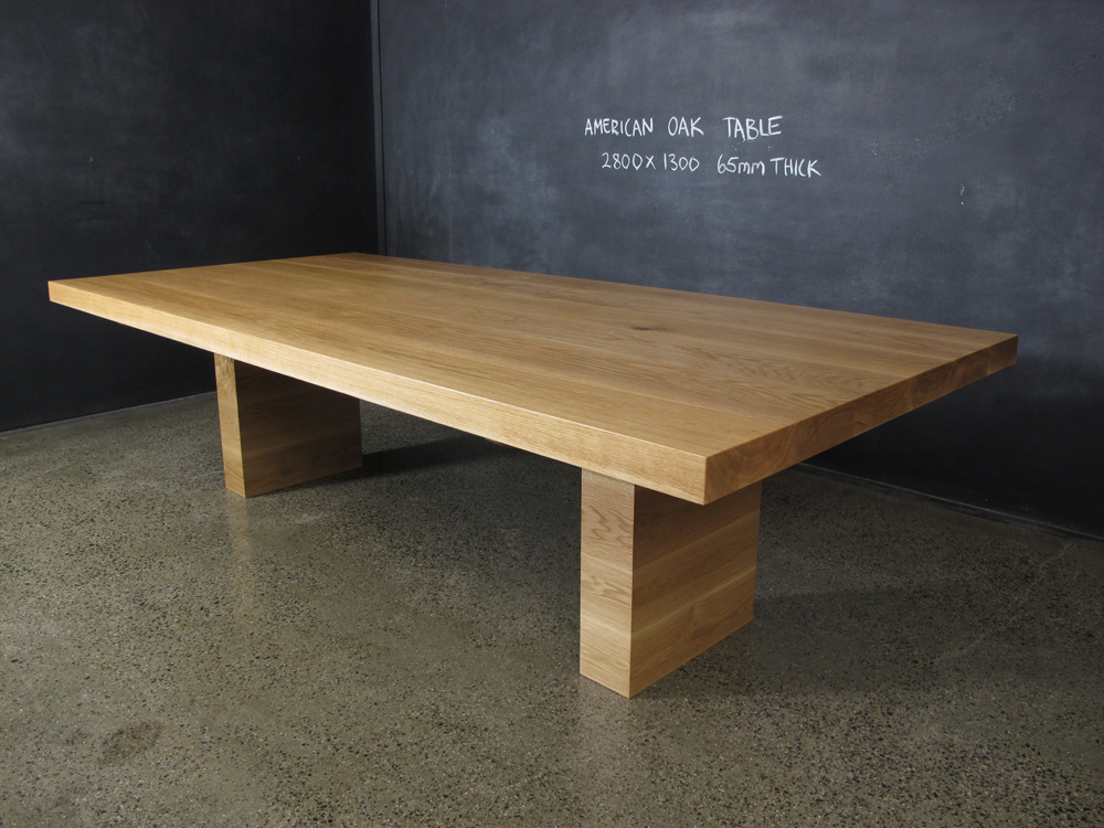 This solid dining table was handmade and designed by Chrisian Cole Furniture, Brunswick VIC.  The Amercian Oak is 60mm thick and the base's practical design enables lots of people to sit around it.