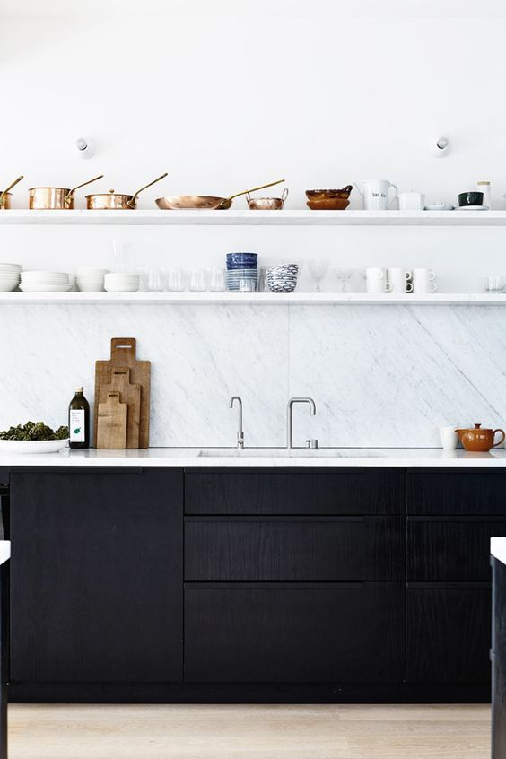 The strength of black is often emphasised by using it with white.  Checkered tiles are a classic example and white marble is a more current example.     image via  myscandinavianhome.com