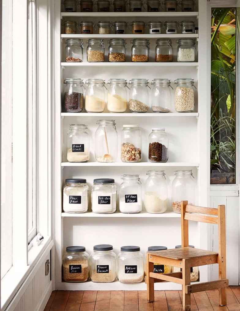 Notice how this is laid out from small jars at the top to large at the bottom. The shelf heights are adjusted to exactly the right height.   source:  thedesignfiles.net