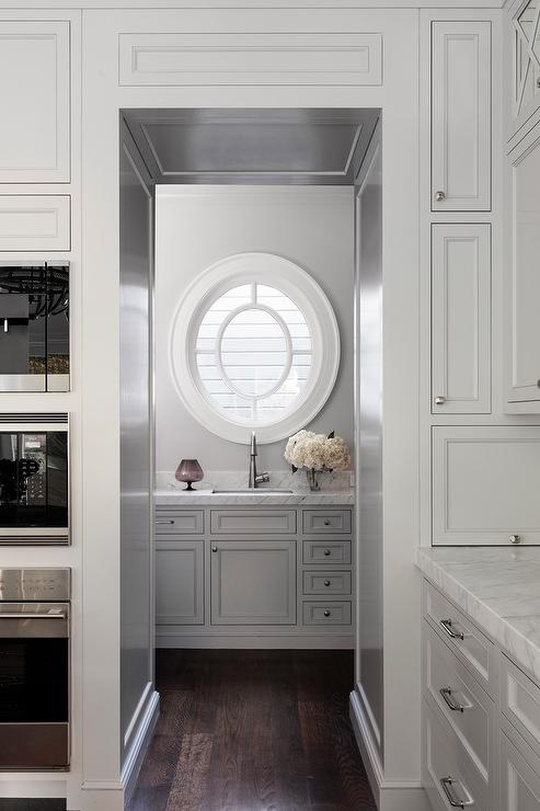 Another oval window. It's a wonderful focal point and somehow balances all the straight edges of the joinery.   source:  decorpad.com