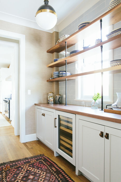 Another way to incorporate a window in your pantry design is to simply shelve over it. Maximum light and maximum storage space. | designed by  Kate Marker Interiors