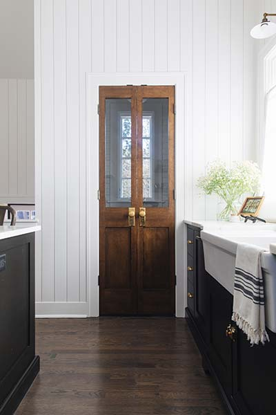 Antique doors in a fresh new kitchen, stunning. | designed by:  reDesign Home