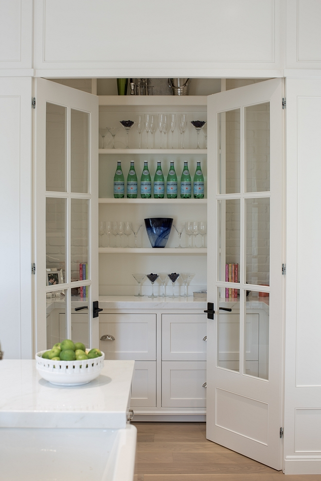 A grand butlers pantry, a showpiece really. Glass doors, white joinery and marble benchtops. Classic. | built by:  LunDev Custom Homes