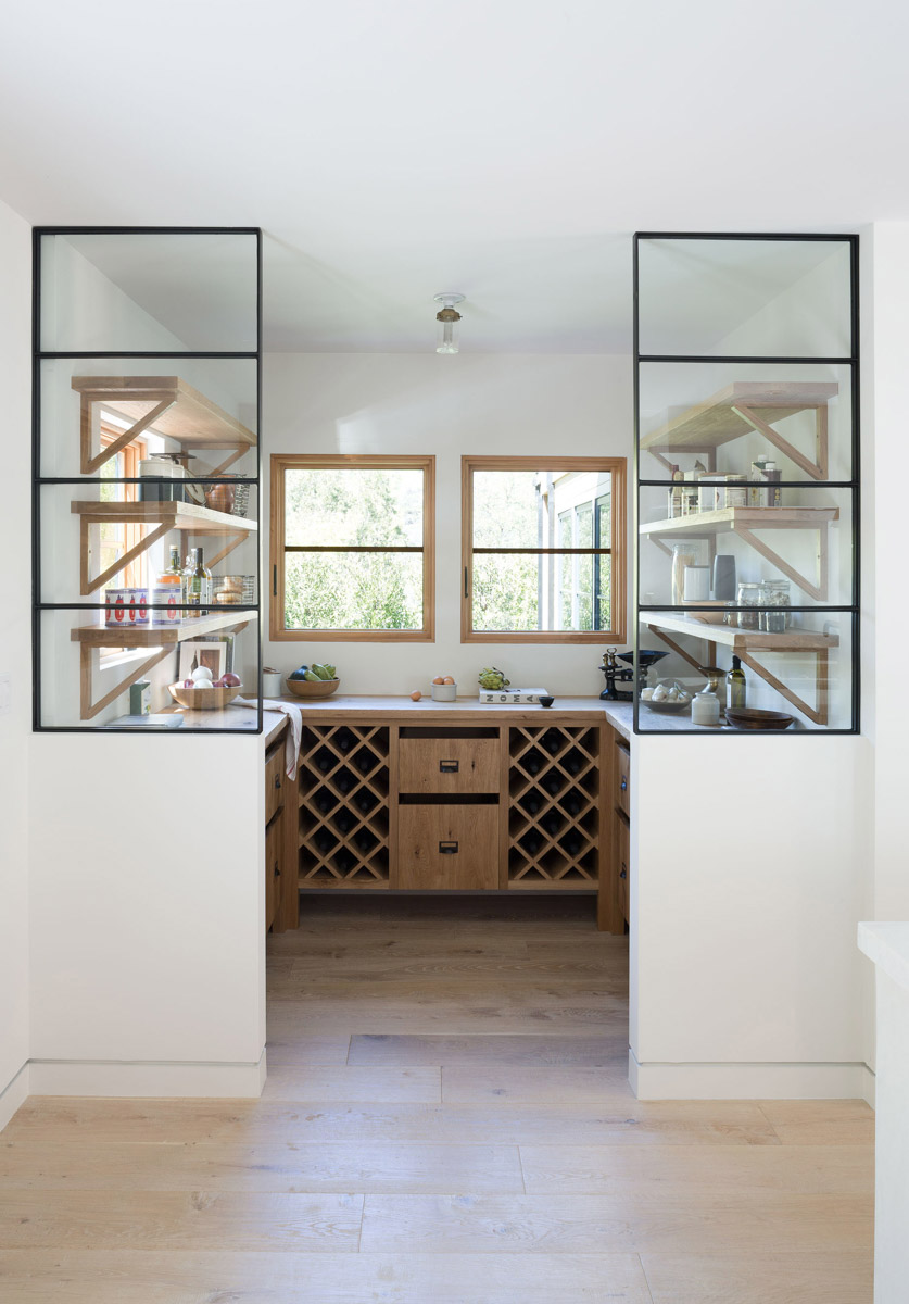 I love the openness and symmetry of this pantry design. It's quite unique. | designed by:  Simo Design