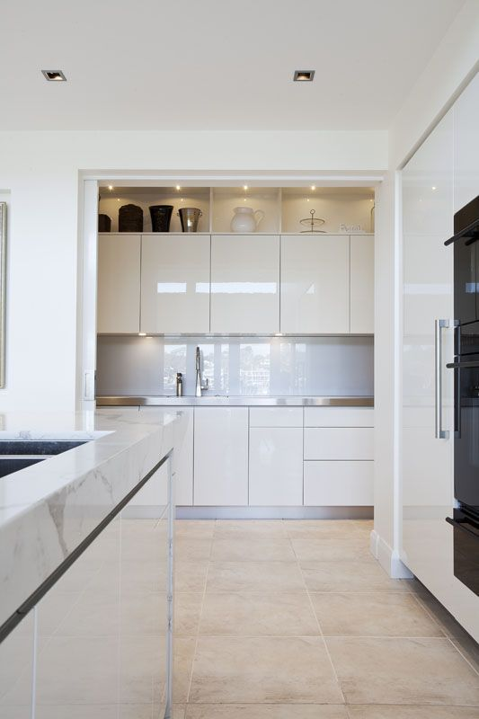 The large opening to this scullery has cavity sliding door access. Great traffic flow and no door to navigate around when it's open, the door tucks away nicely and neatly when it's open. This kitchen's suitable for many cooks (and dishwashers) at the same time. | designed and built by:  Dan Kitchens