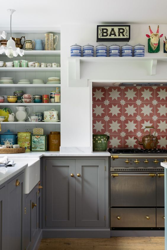 Playful red and white star tiles in this British kitchen by  deVOL . They're Spanish encaustic tiles made with natural pigments.