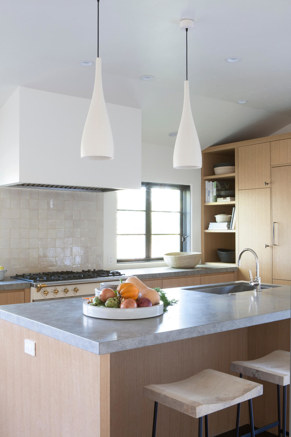 Another example of white (or off white) Zellige tiles for the kitchen splashback. Interior Design:  DISC Interiors