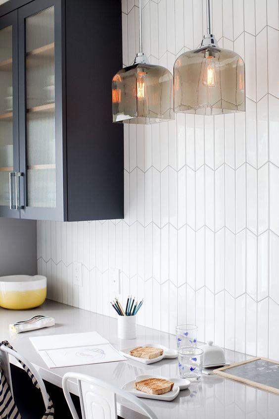 White geometric tiles are never boring. Interior design by HGTV personality  Jillian Harris