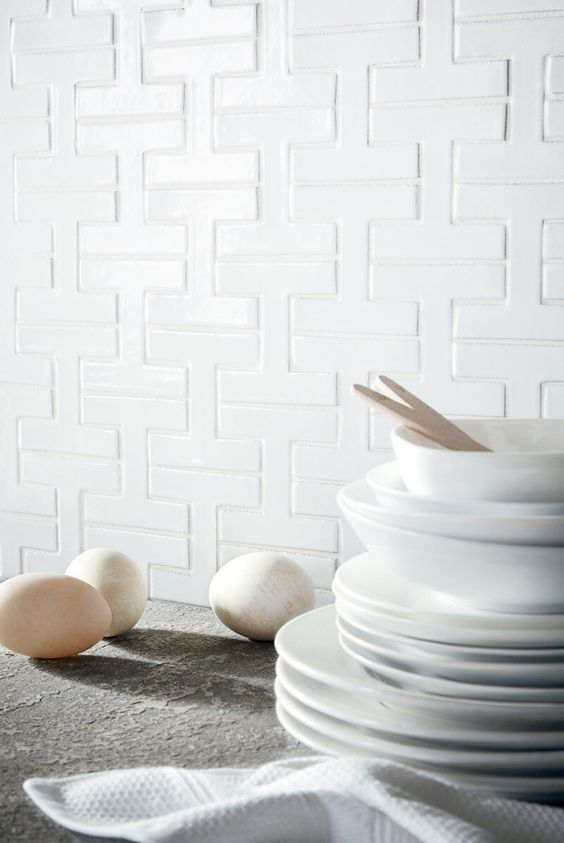 """Interlocking """"H"""" shaped geometric tiles called Chaine Homme, by  Fireclay Tile . It has a mid-century modern appeal."""