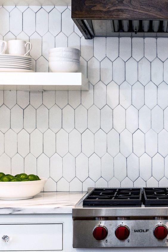 Matte white, picket shaped, handmade clay tiles. Interior design:  Melinda Faranetta