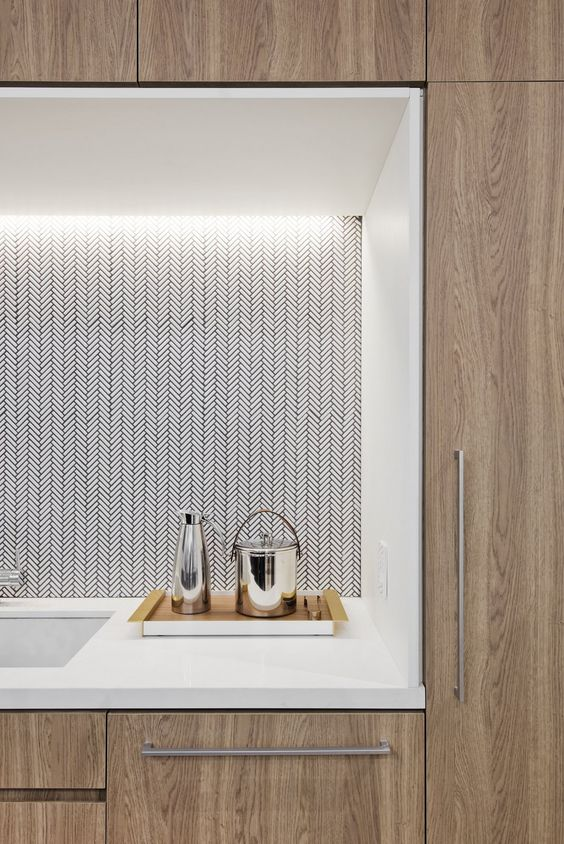 Tiny white tiles in a herringbone pattern with dark grout, a woven fabric look. Architecture & interiors:  Fogarty Finger