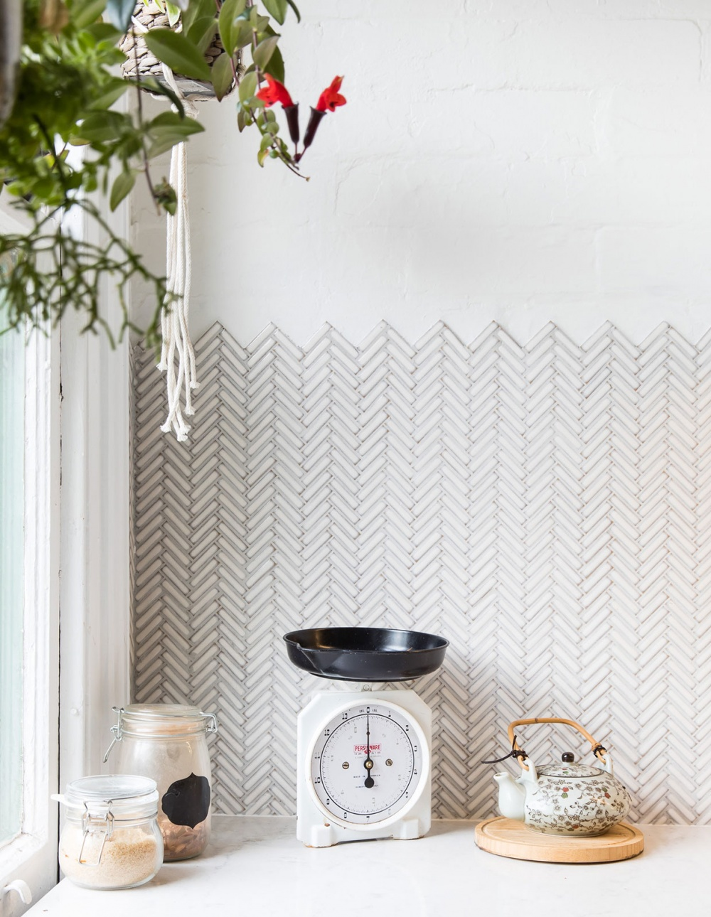 Tiny herringbone tiles with unfinished zigzag edge, lovely. An artist's home, photo credit:  The Design Files