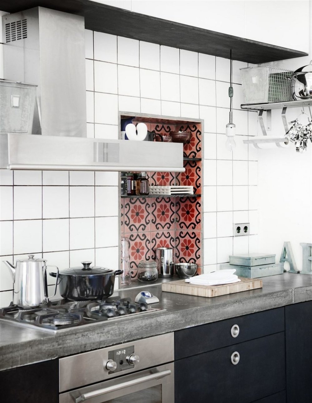 Encaustic cement tiled niche in this industrial-scandi kitchen. Image credit:  Leva & Bo