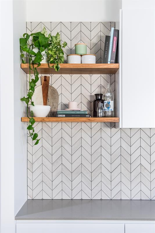 White chevron tiles with grey grout. Kitchen designed and made by:  Loughlin Furniture