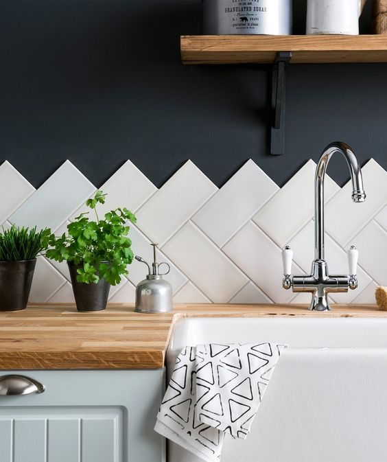 An unfinished edge using white subway tiles (on diagonal) and black wall is quite dramatic. Image source:  Topps Tiles