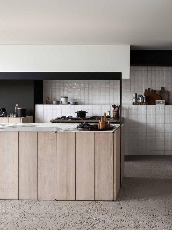 Luxe and rustic kitchen featuring handmade tiles laid in a simple grid pattern. Interior Architects:  Frederic Kielemoes  and Vanessa Cauwe