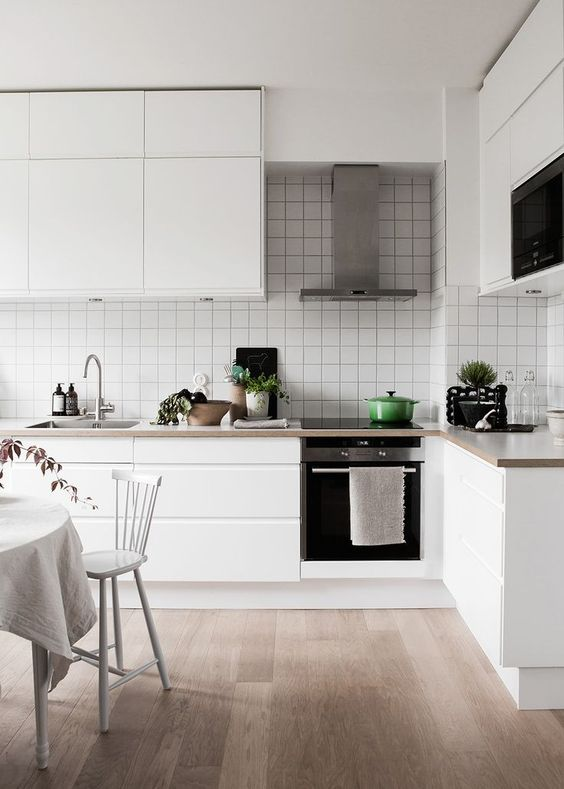 Simple Scandinavian kitchen with white grid tiles. Photography & Styling:  Daniella Witte