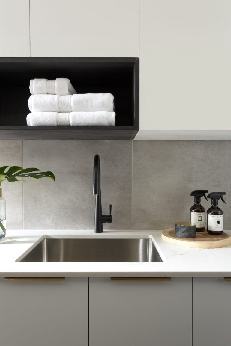 Affordable concrete look tiles on this laundry room splashback. Image source:  getinmyhome.com