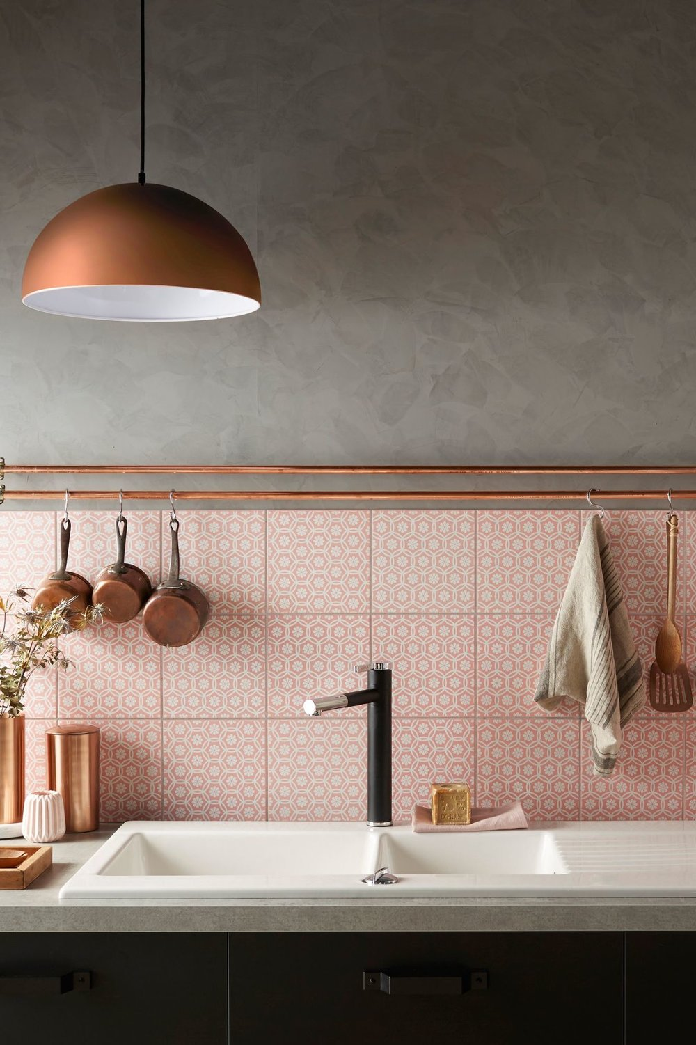 Blush tiles: styled with copper, concrete grey benchtop and wall, black tapware and cabinets. Image source:  Cote Maison
