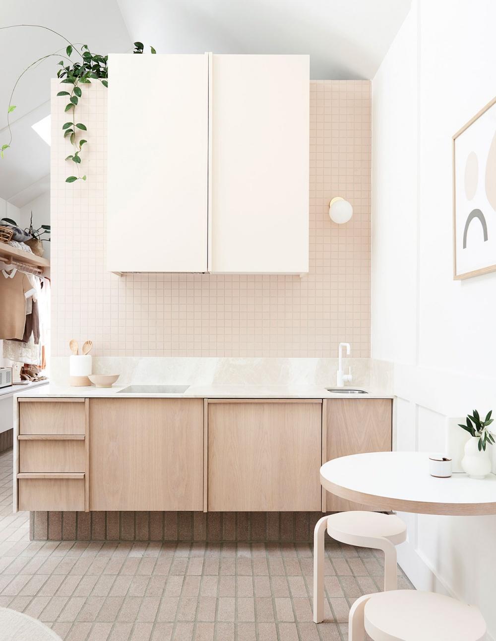 Soft pink tiles, blonde timber cabinetry and crisp white details. Interior design:  Bicker Design