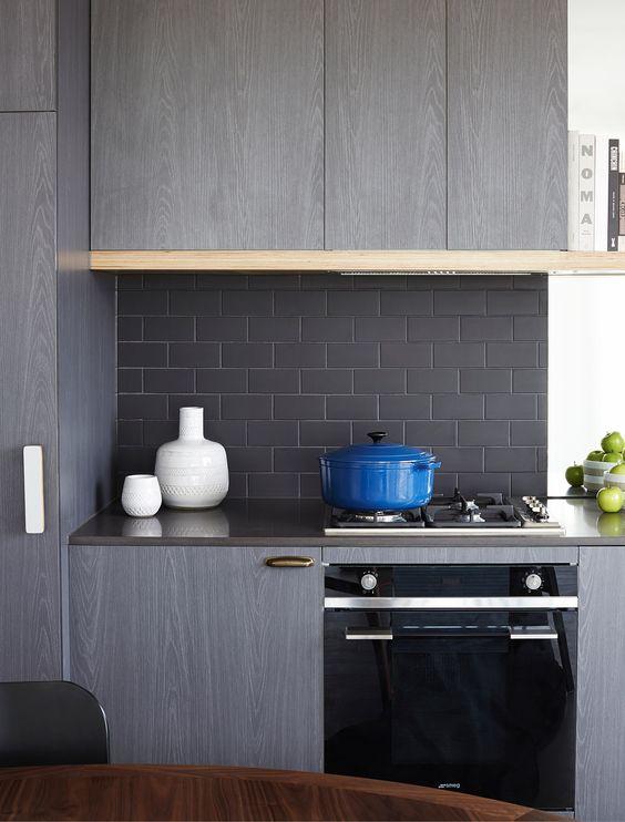 North Fitzroy, Graphite Apartments that embody urban style living. Matte black subway tile, brick bond layout. Interior Design:  Mim Design