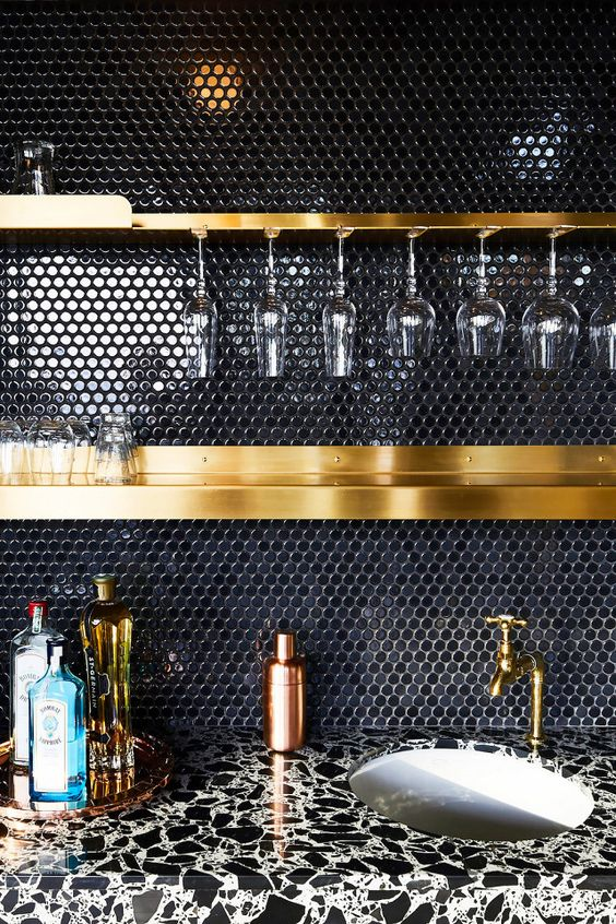 Black gloss penny round tiles for a glamorous evening drinking cocktails. Designed by:  GRT Architects