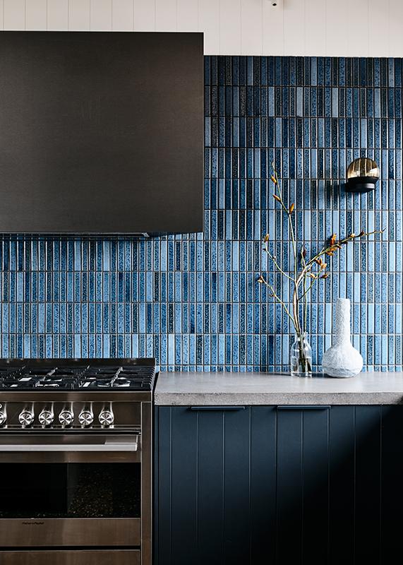 Blue finger tiles, mid-century modern style. Interior Design:  Doherty Design Studio