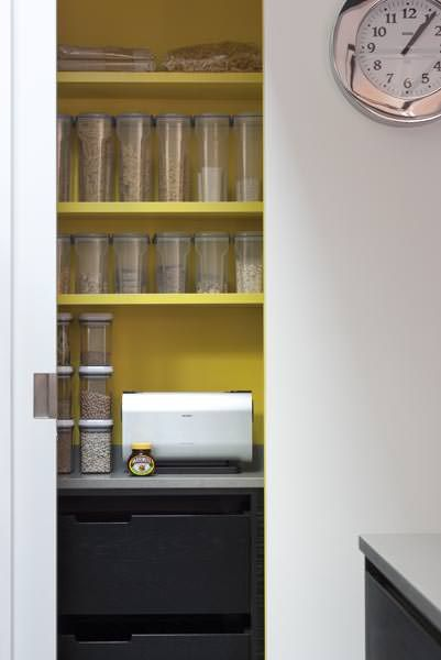 A pop of zesty lemon yellow in this modern pantry.  Mowlem & Co