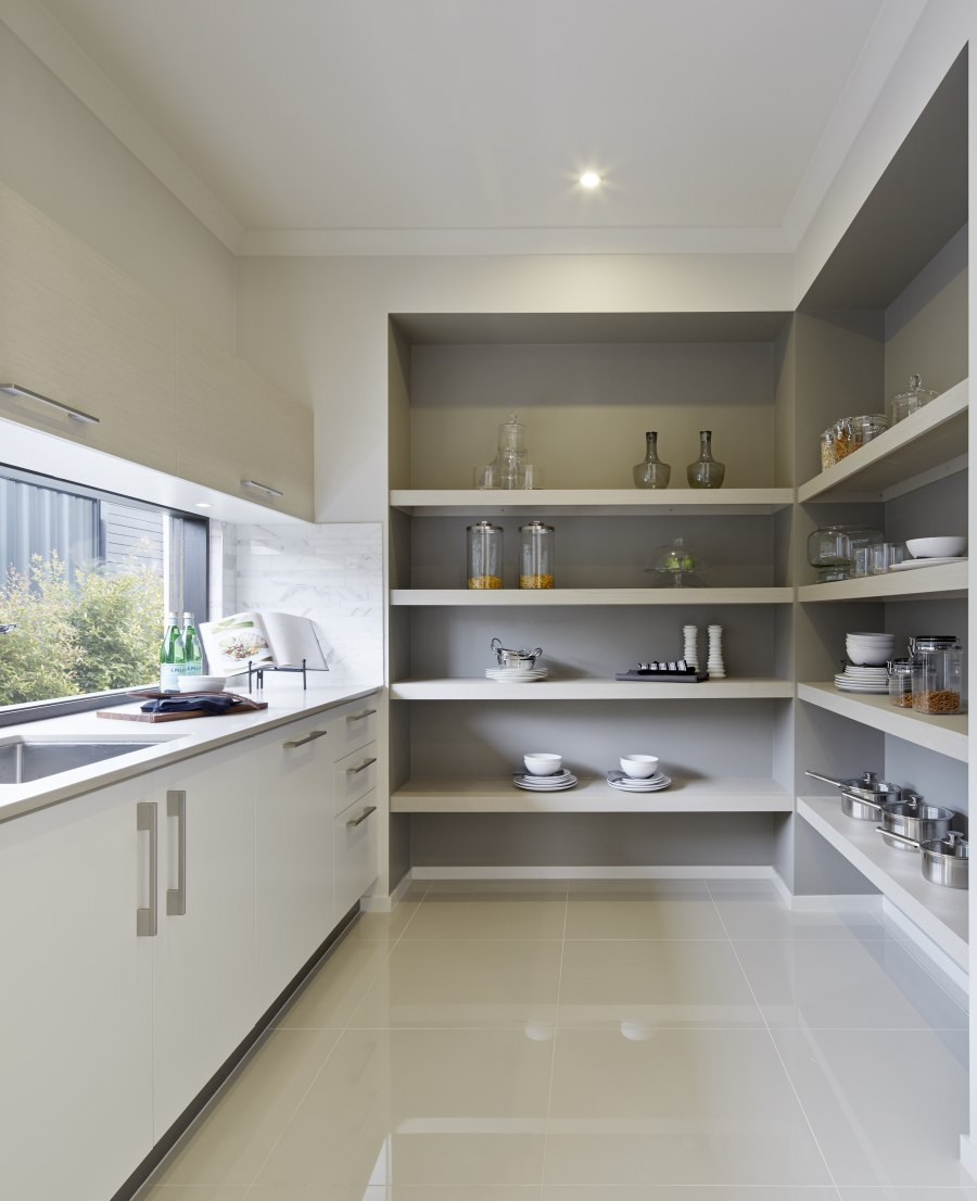 A bulters pantry with grey painted shelf alcoves, looking very classy.  Metricon