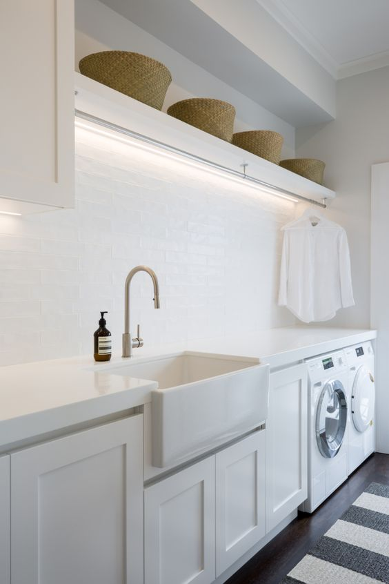 A fresh, Hamptons style laundry with ample hanging space. Notice the clever strip lighting above. |  Janey Larsen Design