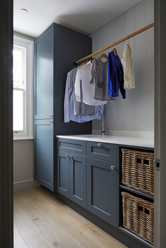 There's something very appealing about a simple timber rod for hanging laundry. |  Shootfactory