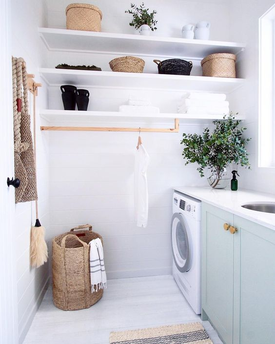 This laundry's got great hanging space, using a custom timber rail. |  Maddy Evennett