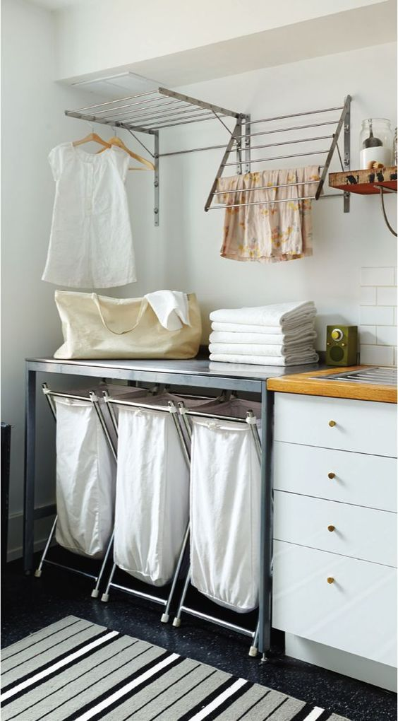 Stainless steel dryer racks are great for either using hangers or just using the bars to hang clothes to dry. The hanging washing bags are great too. |  Ikea