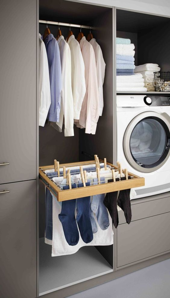 I like the idea of a drying rack drawer below a hanging rail in the laundry. It's a great German design. |  Schuller