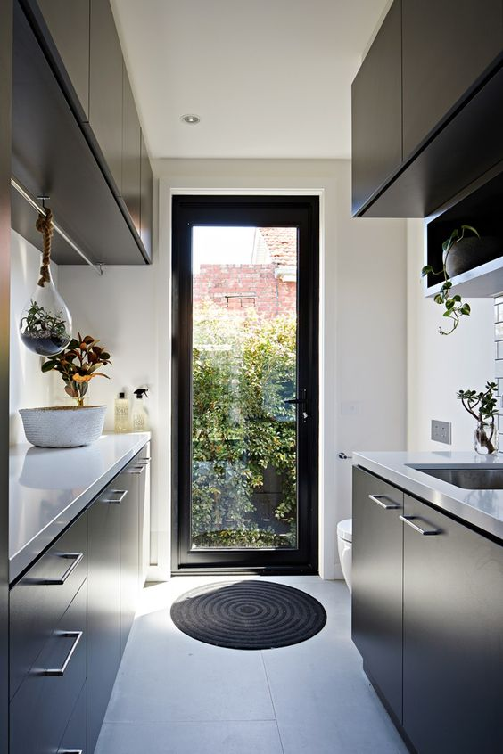 I adore the use of plants in this laundry, especially the terrarium hanging from the clothes rail! |  Archiblox