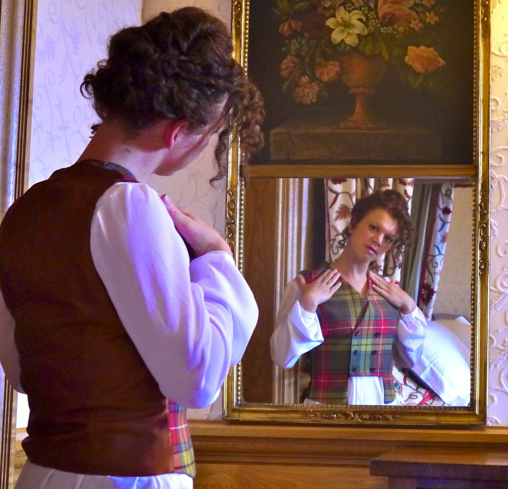 lady looking at herself in mirror tartan waistcoat lorna gillies scottish fashion