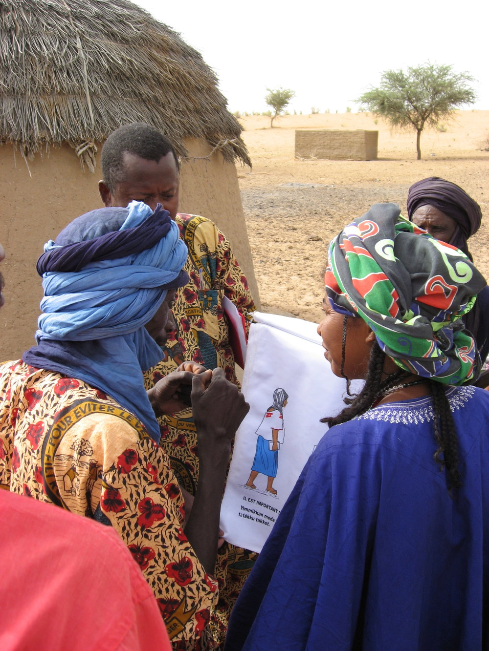 Workers in Niger teach villagers about the danger of prolonged obstructed labor.