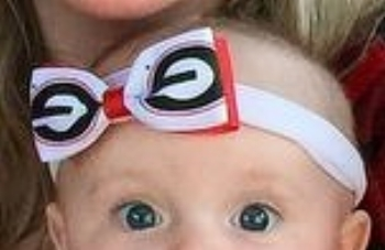 There are acceptable occasions for 'bowing' the baby, though I'm saddened that this Georgia mom didn't know the 'G' was upside down.