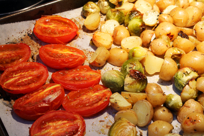 Tomatoes for the sauce roasting alongside the sprouts and potatoes