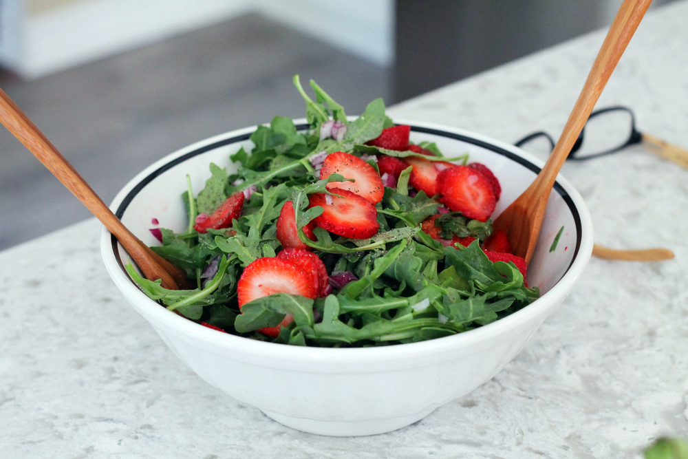 My mom whips up a fresh arugula and strawberry salad.