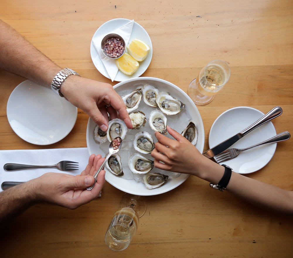 $1 Oysters, 1/2 off Bubbly, Fried Chicken