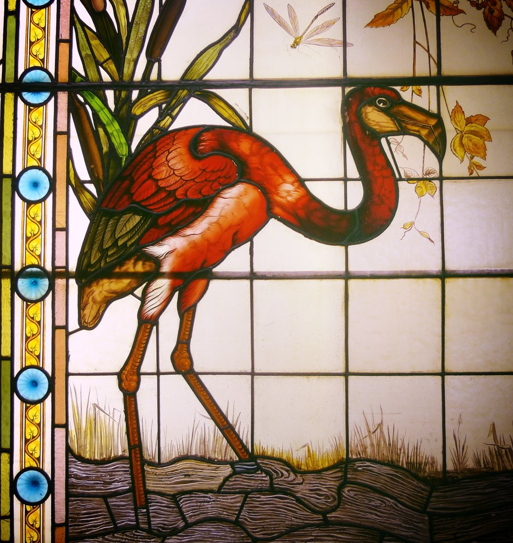 Detail from a mysterious stained glass window, housed in the Booth Museum, whose artist is unknown.