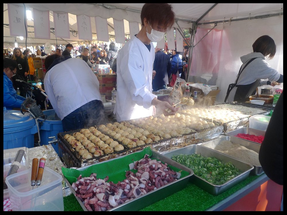 Getting our first batch of Takoyaki at the Fushimi Shrine.